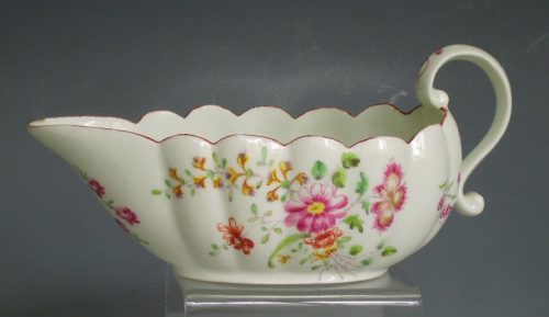 Derby porcelain fluted sauceboat with scroll handle.