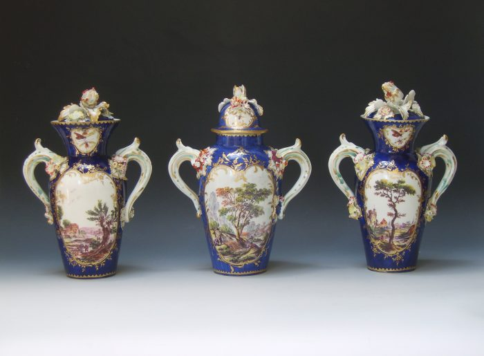 A very rare garniture of Derby vases